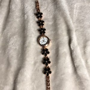 Accessories - Rose gold watch with black flower metallic band